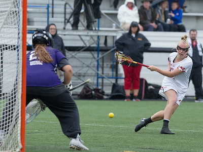 Maryland's Caroline Steele records two goals against Nortwestern in the heavy rain. PHOTO BY MIKE CLARK