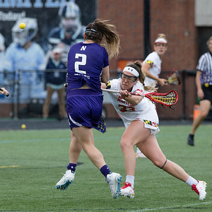 Maryland's Erica Evans applies pressure but not before Northwestern's Selena Lasota releases this shot that got by Terps' Goalie Megan Taylor. PHOTO BY MIKE CLARK