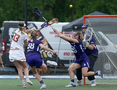 Erica Evans of Maryland scores the first of her two goals in the Big10 championship. PHOTO BY MIKE CLARK