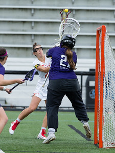 Grace Griffin of Maryland drops in a score over Northwestern Goalie to keep the Terps in the game. PHOTO BY MIKE CLARK