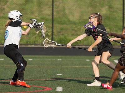 Kayla Brennan scores one of Dulaney's 17 goals in the Maryland 4A semi-finals against Eleanor Roosevelt. PHOTO BY MIKE CLARK