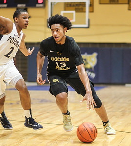 January 11, 2019: Oxon Hill forward Marcus Gorham (12) drives past Potomac forward Elijah Crawford (2) during HS boys basketball action between Oxon Hill HS and Potomac HS in Glassmanor. Photo by: Chris Thompkins/Prince Georges Sentinel