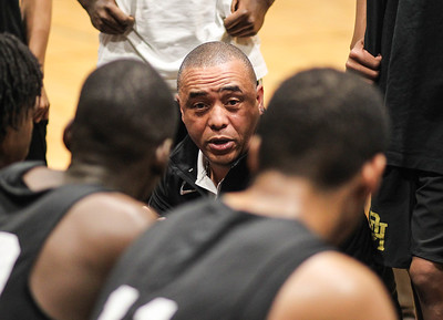 January 11, 2019: Oxon Hill Coach Lewis Howard speaks to his team during HS boys basketball action between Oxon Hill HS and Potomac HS in Glassmanor. Photo by: Chris Thompkins/Prince Georges Sentinel