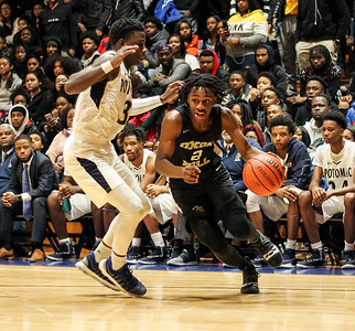 January 11, 2019: Oxon Hill guard Kalonji Parker drives past Potomac guard Sincere Jones (3) during HS boys basketball action between Oxon Hill HS and Potomac HS in Glassmanor. Photo by: Chris Thompkins/Prince Georges Sentinel
