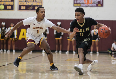 January 4, 2019: Paul VI guard Knasir McDaniel (11) drives past McNamara guard Johnathan McGriff (1) during HS Boys Basketball action between Paul VI HS and McNamara HS in Forestville. Photo by: Chris Thompkins/Prince George's Sentinel