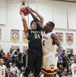 January 4, 2019: Paul VI guard Josiah Freeman (24) gets fouled by McNamara wingman Brandon Joyner (4) during HS Boys Basketball action between Paul VI HS and McNamara HS in Forestville. Photo by: Chris Thompkins/Prince George's Sentinel