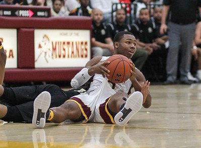 January 4, 2019: McNamara guard Kenneth Womack (5) gains possession of a loose ball during HS Boys Basketball action between Paul VI HS and McNamara HS in Forestville. Photo by: Chris Thompkins/Prince George's Sentinel