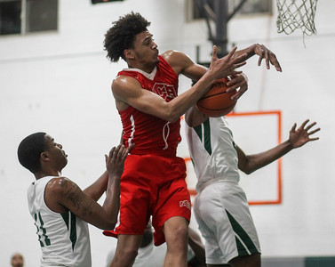 February 15, 2019: National Christian guard Jakai Robinson (11) battles Rock Creek defenders for a rebound during HS boys basketball action between National Christian Academy vs Rock Creek Christian Academy in Rosaryville. Photo by: Chris Thompkins/Prince George's Sentinel