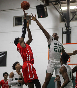 February 15, 2019: National Christian forward Josiah Gregg (23) shoots over Rock Creek forward Jacob Douglas (20) during HS boys basketball action between National Christian Academy vs Rock Creek Christian Academy in Rosaryville. Photo by: Chris Thompkins/Prince George's Sentinel