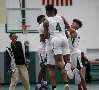February 15, 2019: Rock Creek players embrace forward Zakir Williamson (23) after scoring the game winning basket during HS boys basketball action between National Christian Academy vs Rock Creek Christian Academy in Upper Marlboro. Photo by: Chris Thompkins/Prince George's Sentinel