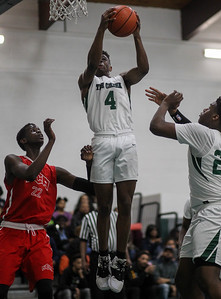 February 15, 2019: Rock Creek guard James Gross (4) grabs a rebound during HS boys basketball action between National Christian Academy vs Rock Creek Christian Academy in Upper Marlboro. Photo by: Chris Thompkins/Prince George's Sentinel