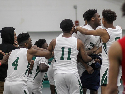 February 15, 2019: Rock Creek players celebrate after defeating National Christian in the final seconds of  HS boys basketball action between National Christian Academy vs Rock Creek Christian Academy in Rosaryville. Photo by: Chris Thompkins/Prince George's Sentinel