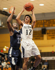 February 22, 2019: Potomac guard Santana Williams (12) shoots the ball past Central forward Ronald Heiligh (23) during HS boys basketball action between Central HS and Potomac HS in Oxon Hill. Photo by: Chris Thompkins/Prince George's Sentinel