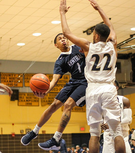 February 22, 2019: Central guard Dillian Moore (1) goes past Potomac forward Kevin Dozier(22) for a layup during HS boys basketball action between Central HS and Potomac HS in Oxon Hill. Photo by: Chris Thompkins/Prince George's Sentinel