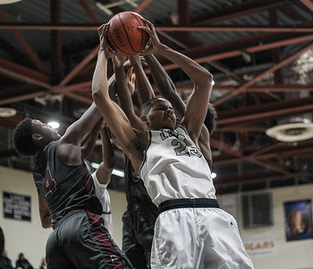 March 1, 2019: Largo forward Destin Harris (25) grabs a rebound from Fairmont Heights defenders during HS boys basketball action between Fairmont Heights HS and Largo HS in Largo. Photo by: Chris Thompkins/Prince Georges Sentinel