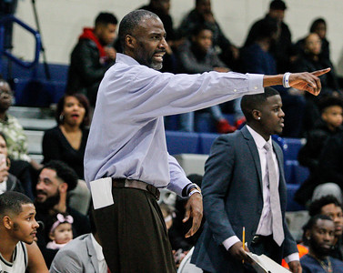March 1, 2019: Largo coach Rodney Ward directs his team during HS boys basketball action between Fairmont Heights HS and Largo HS in Largo. Photo by: Chris Thompkins/Prince Georges Sentinel