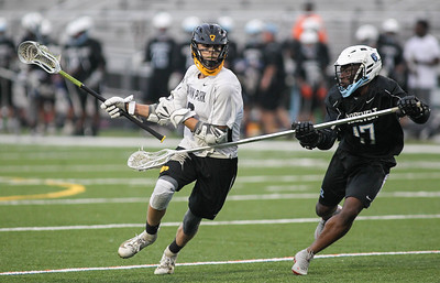 May 4, 2019: Gwynn Park midfielder Edward Porterfield (9) tries to get past Roosevelt defender Joseph Niba (17) during PG County boys lacrosse championship between Gwynn Park HS and E. Roosevelt HS in Glen Dale. Photo by: Chris Thompkins/Prince Georges County Sentinel