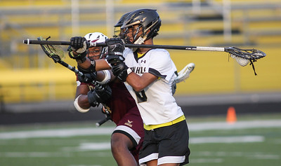 April 25, 2019: Oxon Hill midfielder Ian Harvey-Thomas (6) takes a shot on a Douglass defender during HS boys lacrosse action between Douglass HS and Oxon Hill HS. Photo by: Chris Thompkins/Prince Georges Sentinel
