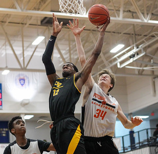 June 9, 2019: Gwynn Park Darious Boyd (12) goes for a layup past Potomac Jay Kiernan (34) during Capitol Hoops Summer League action between Potomac School and Gwynn Park HS in Hyattsville, Maryland. Photos by Chris Thompkins/Prince Georges Sentinel