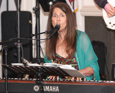 February 23, 2019: Strangers Band pianist Julie Parsons performs during the Winter Dinner/Dance Christmas in April event in Clinton. Photo by: Chris Thompkins/Prince George's Sentinel