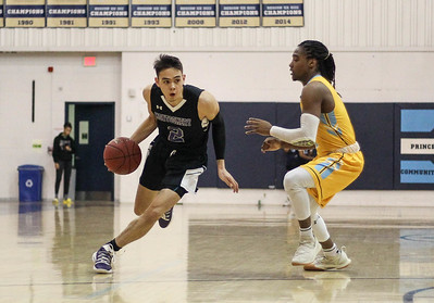 January 23, 2019: Montgomery guard Paul Garcia (2) drives past PGCC guard Tunde Scrivner (1) during JUCO mens basketball action between Montgomery Community College and Prince George's Community College in Largo. Photo by: Chris Thompkins/Prince Georges Sentinel