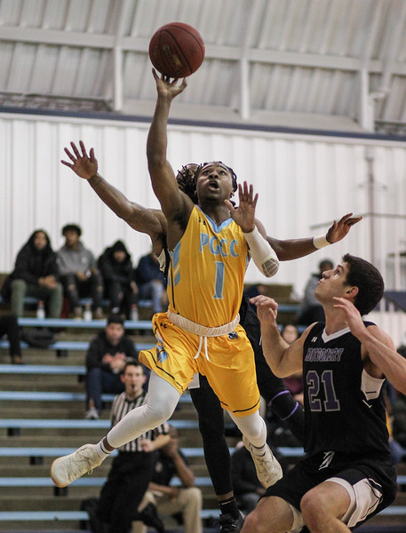 January 23, 2019: PGCC guard Tunde Scrivner (1) attempts a layup over Montgomery defenders during JUCO mens basketball action between Montgomery Community College and Prince George's Community College in Largo. Photo by: Chris Thompkins/Prince Georges Sentinel