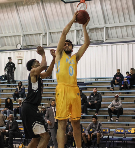 January 23, 2019: PGCC forward Moetaz Ashkar (0) shoots over an Montgomery defender during JUCO mens basketball action between Montgomery Community College and Prince George's Community College in Largo. Photo by: Chris Thompkins/Prince Georges Sentinel
