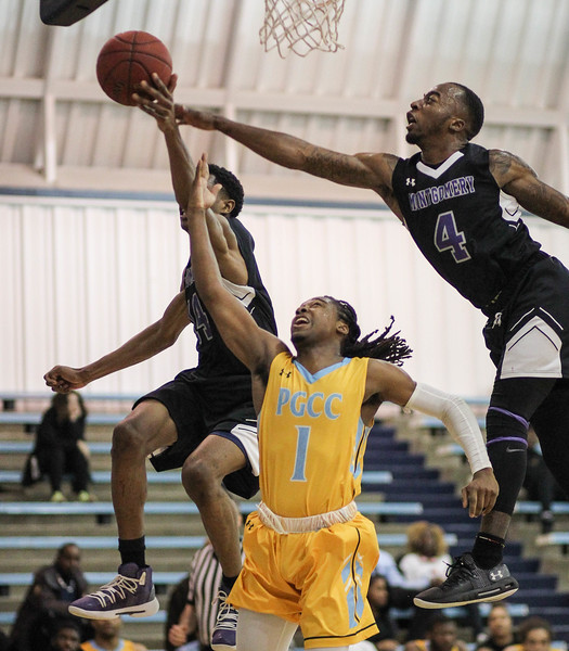 January 23, 2019: Montgomery defenders Vince Rose (4) and Johnathan Kamana (14) blocks PGCC guard Tunde Scrivner (1) layup during JUCO mens basketball action between Montgomery Community College and Prince George's Community College in Largo. Photo by: Chris Thompkins/Prince Georges Sentinel