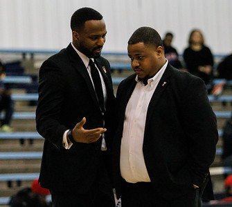 January 23, 2019: PGCC Coach William West talks with his coaching staff during JUCO mens basketball action between Montgomery Community College and Prince George's Community College in Largo. Photo by: Chris Thompkins/Prince Georges Sentinel