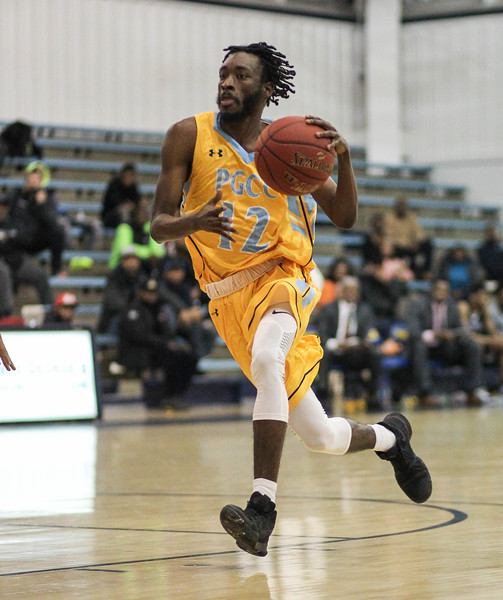 January 23, 2019: PGCC guard Dexter Turner (12) drives to the basket during JUCO mens basketball action between Montgomery Community College and Prince George's Community College in Largo. Photo by: Chris Thompkins/Prince Georges Sentinel