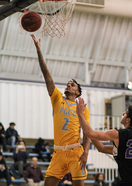 January 23, 2019: PGCC guard Alex Morales (2) attempts a layup during JUCO mens basketball action between Montgomery Community College and Prince George's Community College in Largo. Photo by: Chris Thompkins/Prince Georges Sentinel