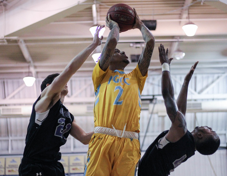 January 23, 2019: PGCC guard Alex Morales (2) attempts a layup over Montgomery defenders during JUCO mens basketball action between Montgomery Community College and Prince George's Community College in Largo. Photo by: Chris Thompkins/Prince Georges Sentinel