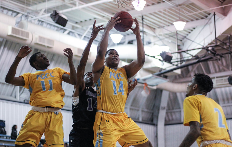 January 23, 2019: PGCC center Darren Rivers (14) grabs a rebound during JUCO mens basketball action between Montgomery Community College and Prince George's Community College in Largo. Photo by: Chris Thompkins/Prince Georges Sentinel