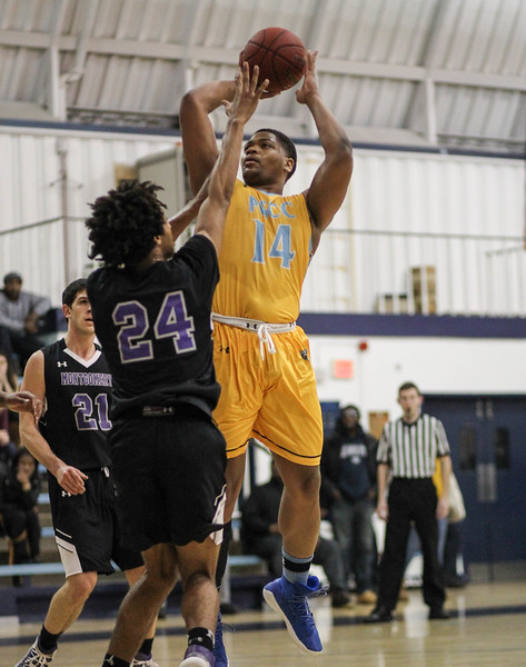 January 23, 2019: PGCC center Darren Rivers (14) shoots a jumpshot during JUCO mens basketball action between Montgomery Community College and Prince George's Community College in Largo. Photo by: Chris Thompkins/Prince Georges Sentinel