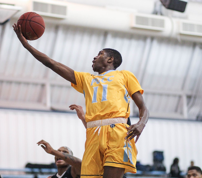 January 23, 2019: PGCC guard Jalen Robinson (11) attempts a layup during JUCO mens basketball action between Montgomery Community College and Prince George's Community College in Largo. Photo by: Chris Thompkins/Prince Georges Sentinel