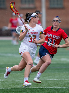 College Park, MD, Sunday, May 12, 2019: Maryland Terrapins Erica Evans (33) gets past Stony Brook Seawolves Nicole Barretta (81) during a NCAA Women's Lacrosse second round matchup between Stony Brook and Maryland played at Capital One Field at Maryland Stadium in College Park, MD. (Michael R. Smith/The Prince George's Sentinel).
