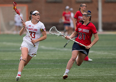 College Park, MD, Sunday, May 12, 2019: Maryland Terrapins Erica Evans (33) looks to get past Stony Brook Seawolves Nicole Barretta (81) during a NCAA Women's Lacrosse second round matchup between Stony Brook and Maryland played at Capital One Field at Maryland Stadium in College Park, MD. (Michael R. Smith/The Prince George's Sentinel).