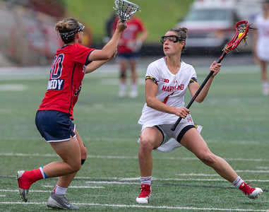 College Park, MD, Sunday, May 12, 2019: Maryland Terrapins Jen Giles (5) looks to get past Stony Brook Seawolves Ally Kennedy (30) during a NCAA Women's Lacrosse second round matchup between Stony Brook and Maryland played at Capital One Field at Maryland Stadium in College Park, MD. (Michael R. Smith/The Prince George's Sentinel).