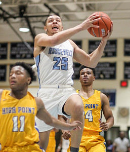 March 8, 2019: E. Roosevelt guard (25) Isaiah Cross goes for layup around High Point guard Jerron Clayton (11) during HS boys basketball regional finals between High Point HS and E. Roosevelt HS in Greenbelt. Photo by: Chris Thompkins/Prince Georges Sentinel
