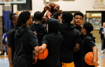 March 8, 2019: High Point players huddle before the HS boys basketball regional finals between High Point HS and E. Roosevelt HS in Greenbelt. Photo by: Chris Thompkins/Prince Georges Sentinel