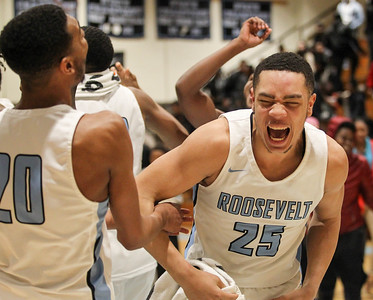 March 8, 2019: E. Roosevelt players Jalon Shell (20) and Isaiah Gross (25) celebrate their victory after HS boys basketball regional finals between High Point HS and E. Roosevelt HS in Greenbelt. Photo by: Chris Thompkins/Prince Georges Sentinel
