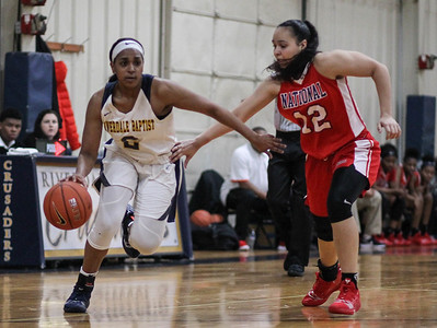 "January 31, 2019: Riverdale Baptist guard Kaylah Ivey (2) drives past National Christian forward Kaiya Creek (22) during HS girls basketball action between National Christian Academy and Riverdale Baptist in Upper Marlboro. Photo by: Chris Thompkins/Prince George""s Sentinel"
