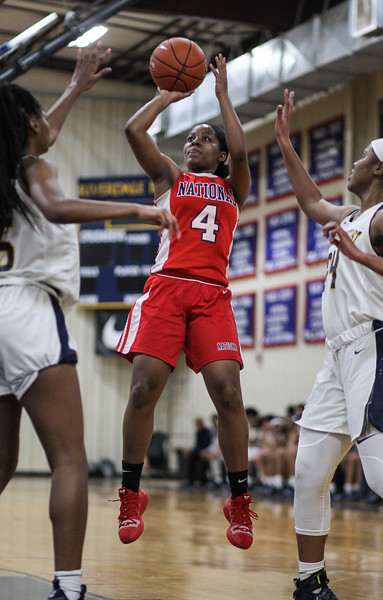 """January 31, 2019: National Christian guard Sonia Smith (4) shoots over Riverdale Baptist defenders during HS girls basketball action between National Christian Academy and Riverdale Baptist in Upper Marlboro. Photo by: Chris Thompkins/Prince George""""s Sentinel"""