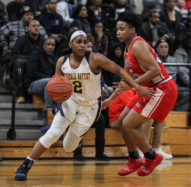 "January 31, 2019: Riverdale Baptist guard Kaylah Ivey (2) drives past National Christian forward Promise Cunningham (35) during HS girls basketball action between National Christian Academy and Riverdale Baptist in Upper Marlboro. Photo by: Chris Thompkins/Prince George""s Sentinel"