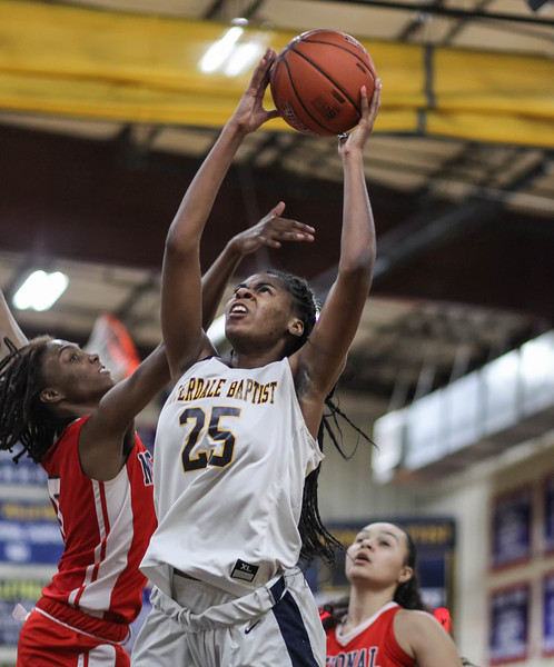"January 31, 2019: Riverdale Baptist forward Rayne Tucker (25) shoots past National Christian forward Anissa Rivera (5) during HS girls basketball action between National Christian Academy and Riverdale Baptist in Upper Marlboro. Photo by: Chris Thompkins/Prince George""s Sentinel"