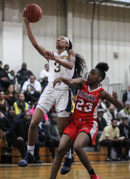 """January 31, 2019: Riverdale Baptist forward Synia Johnson goes for a layup past National Christian forward Jersey Mayfield (23) during HS girls basketball action between National Christian Academy and Riverdale Baptist in Upper Marlboro. Photo by: Chris Thompkins/Prince George""""s Sentinel"""