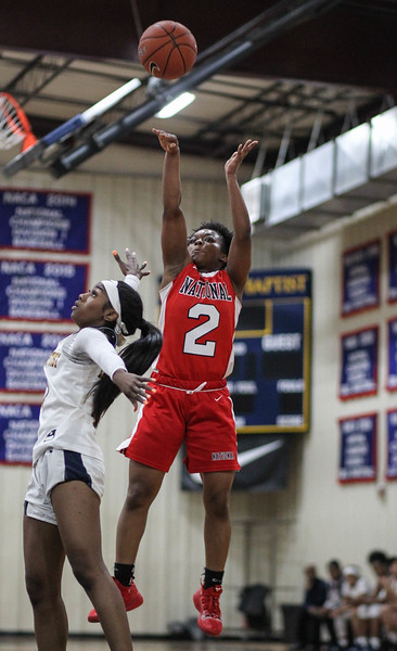 """January 31, 2019: National Christian guard Paige Brown (2) shoots past Riverdale Baptist guard Yanni Hendley (10) during HS girls basketball action between National Christian Academy and Riverdale Baptist in Upper Marlboro. Photo by: Chris Thompkins/Prince George""""s Sentinel"""