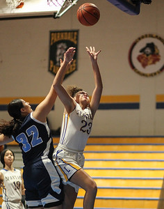 January 25, 2019: Laurel forward Maya Lockett (23) attempts a layup over Northwestern forward Emily Flores (32) during high school girls basketball action between Northwestern HS and Laurel HS in Laurel. Photo by: Chris Thompkins/Prince Georges Sentinel