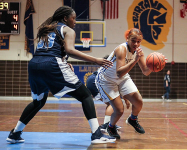 January 25, 2019: Laurel forward Malaika Treadwell (5) drives past Northwestern forward Jazmine King (33) during high school girls basketball action between Northwestern HS and Laurel HS in Laurel. Photo by: Chris Thompkins/Prince Georges Sentinel