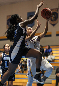 January 25, 2019: Northwestern forward Felicia Tchougoue (2) blocks Laurel guard Sydney Woodland (2) layup during high school girls basketball action between Northwestern HS and Laurel HS in Laurel. Photo by: Chris Thompkins/Prince Georges Sentinel